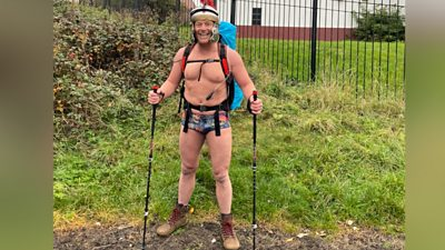 John wore a Roman helmet and his best pair of trunks to take on the 73-mile Hadrian's Wall.