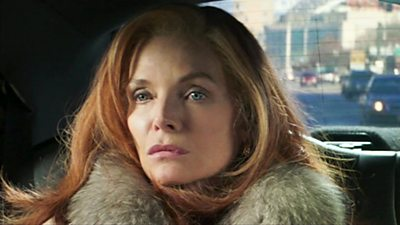 Michelle Pfeiffer sits in the back of a car in a scene from film French Exit