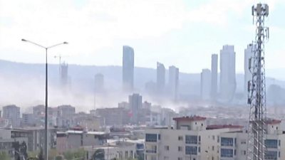 Smoke rising above buildings in Izmir
