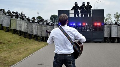 Rock musician Pit Pawlaw singing at a protest rally in Belarus