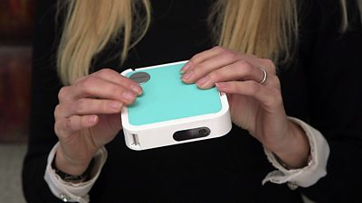 Lara Lewington holds the ViewSonic M1 mini Plus