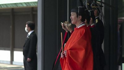 Prince Fumihito waits to enter a carriage