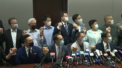 All of Hong Kong's pro-democracy lawmakers have resigned after Beijing dismissed four of their colleagues.