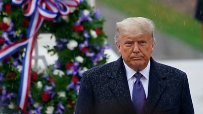 President Trump stands in front of wreath at Arlington National Cemetery