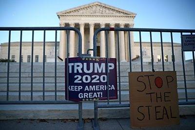 Placards supporting Trump outside Supreme Court