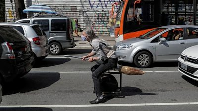 A wheeled broomstick in the middle of road traffic