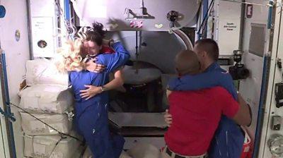 Astronauts hugging