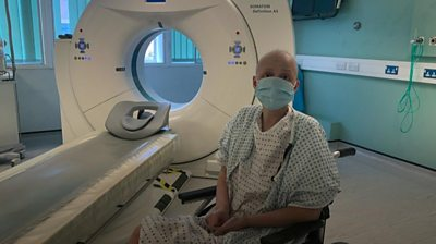 Masha in hospital next to an MRI machine