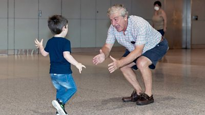 Grandfather welcomes grandchild at Sydney airport
