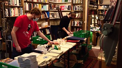 Workers in a bookshop