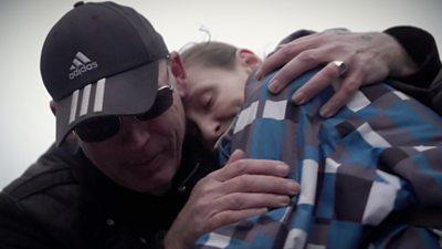 Mick Fleming comforts woman in Burnley