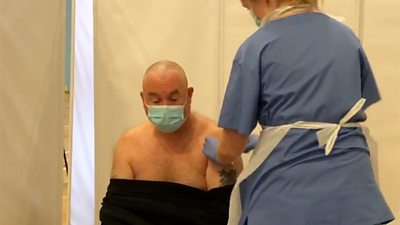 Craig Atkins having a Covid-19 vaccine administered