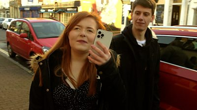 Reporter Lucy Edwards (L) and her friend Dave (R)