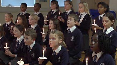 children's school choir holding candles