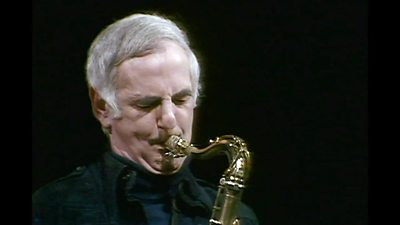 Ronnie Scott playing a saxaphone