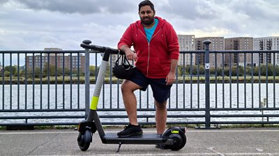Reporter Omar Mehtab on a scooter