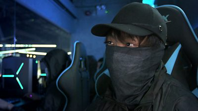 A Hong Kong gamer and protester. They are dressed to protect their anonymity.