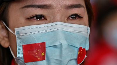 Teary-eyed woman in China