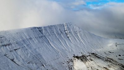 Flying high over south Wales' snow-covered mountains, a drone was used to capture this footage