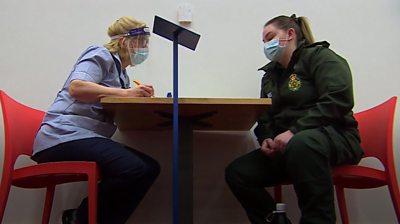 Paramedic inside vaccine centre