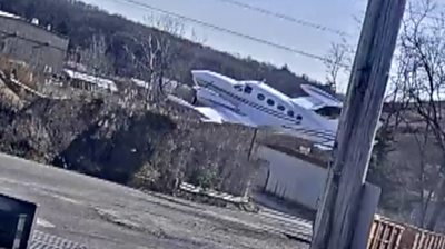 Surveillance footage shows the moment a plane fell out of the sky in Oyster Bay, New York.