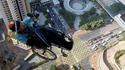 Lai Chi-Wai climbs a skyscraper