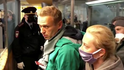 Navalny being detained at the airport