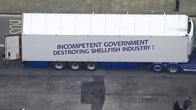 Lorry with protesting slogan about fish trading rules