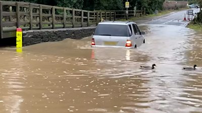 A car travelling through Rufford Lane ford