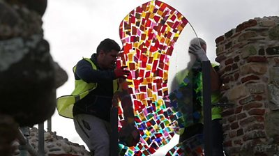 Stained-glass window being installed