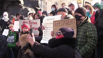 Protesters with placards gather in Vladivostok