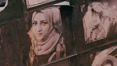 Posters of killed activist Sara Talib Lodya's friend in Basra Square