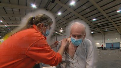 90-year-old Ken got the vaccine at a mass vaccination centre