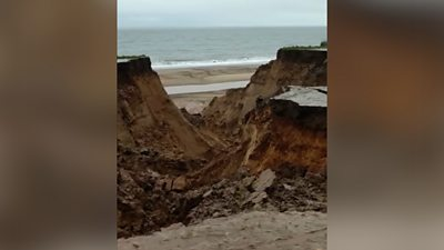 "The coastguard warns mud has washed on to the beach and the cliff remains ""very unstable""."