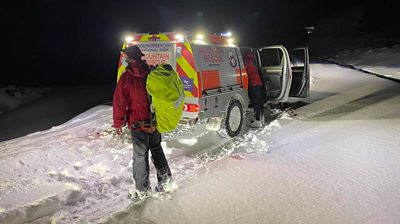 Rescue teams in snow