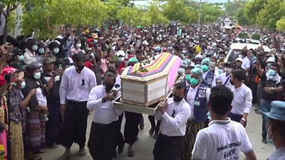Coffing being carried with thousands of people behind it