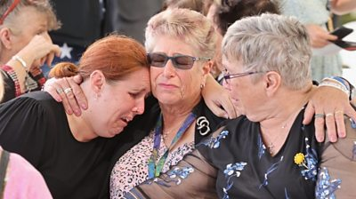 People react during a memorial service to mark the 10th anniversary of the earthquake in Christchurch