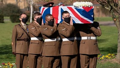 The coffin of Captain Sir Tom Moore is carried by members of the Armed Forces