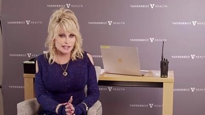 Country singer Dolly Parton appears in a video in which she recieves a Covid-19 vaccine