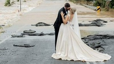 An Australia bride had to be airlifted to her wedding after discovering her family home had been cut off by floods overnight.