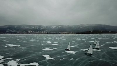 Ice sailboats glide over the deepest freshwater lake in the world