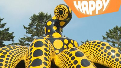 a large artist octopus and the happy logo