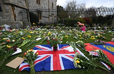 Tributes to Prince Philip laid out in front of Windsor Castle