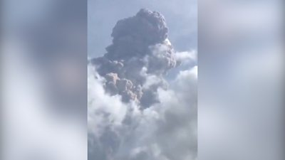 La Soufrière on St Vincent island spews ash 6km into the air as thousands are evacuated.