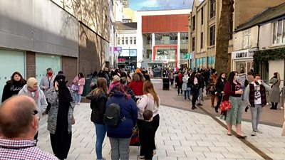 Shoppers queue as stores reopen in Cardiff following the second coronavirus lockdown