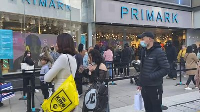 People queue outside a Primark shop.
