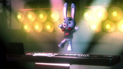 A virtual 3D rabbit jumps in the air while playing a keyboard