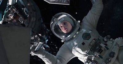 An in-post production shot from The Midnight Sky. Actress Felicity Jones is wearing a space suit