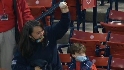 Watch the incredible moment a mother catches a foul ball to protect her child during the Boston Red Sox's 11-7 victory over the Detroit Tigers in the MLB.