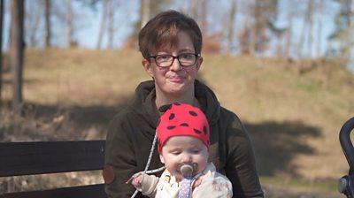 Malin Ostensson holding son Kiran